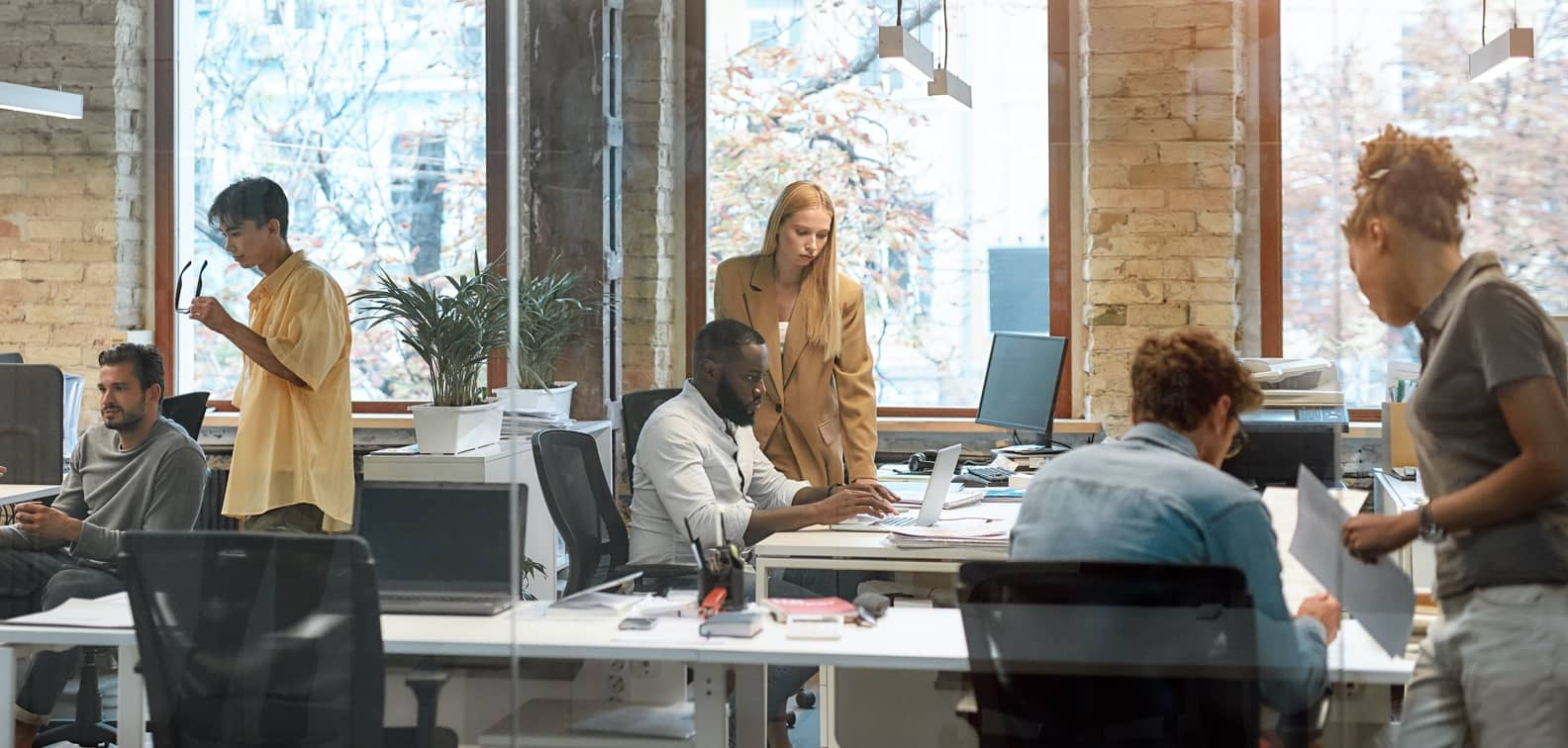 Diverse team of young professionals collaborating in an open-plan office